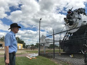 a locomotive engineer for BNSF Railway, paused to admire a surviving relic from the railroad's early days