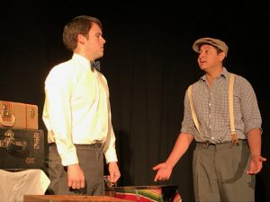 """Zach Hunter  (left), playing famous poet and writer Carl Sandburg, and Daniel Urbina, playing a boy from the Santa Fe boxcar camps named Elias, perform a scene from """"An American Dream: Lincoln, the Railroad and the Transformation of America"""""""