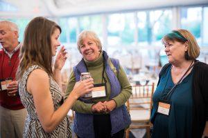 Three woman talking in a circle