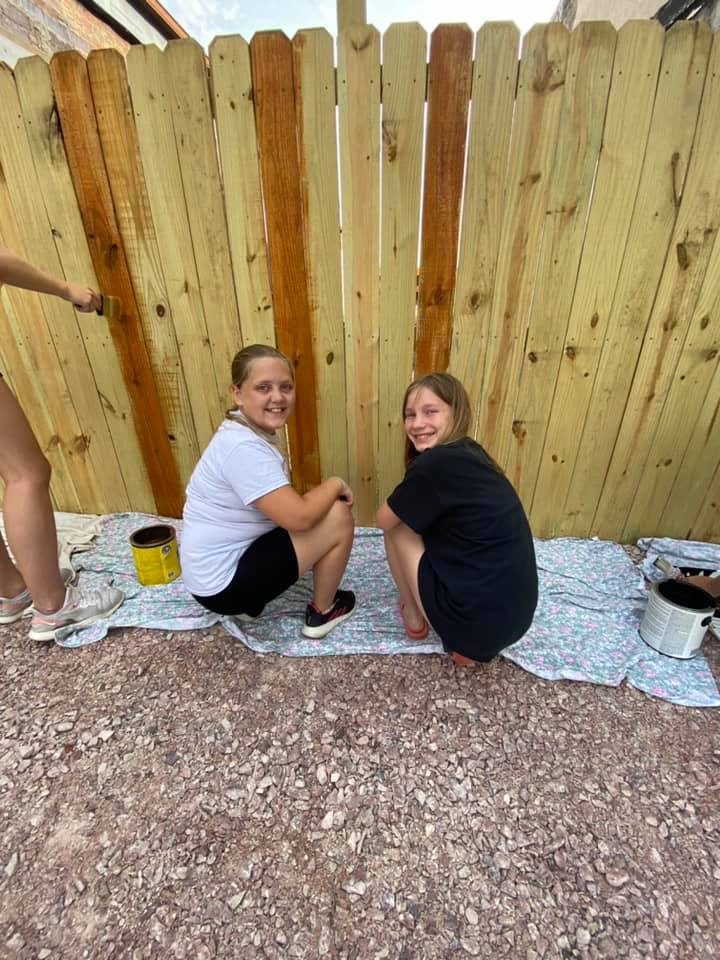 Iowa Akron Youth staining fence